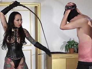 Japanese dominatrix Youko whips and bites the masochist man